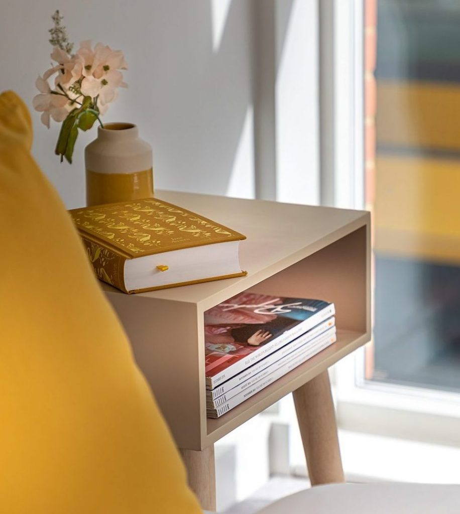 Side table with books in it